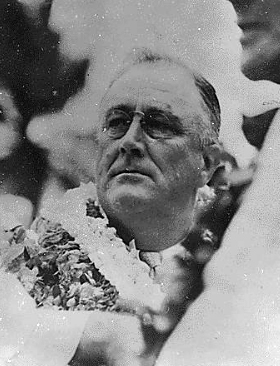 FDR, adorned with flower leis.
