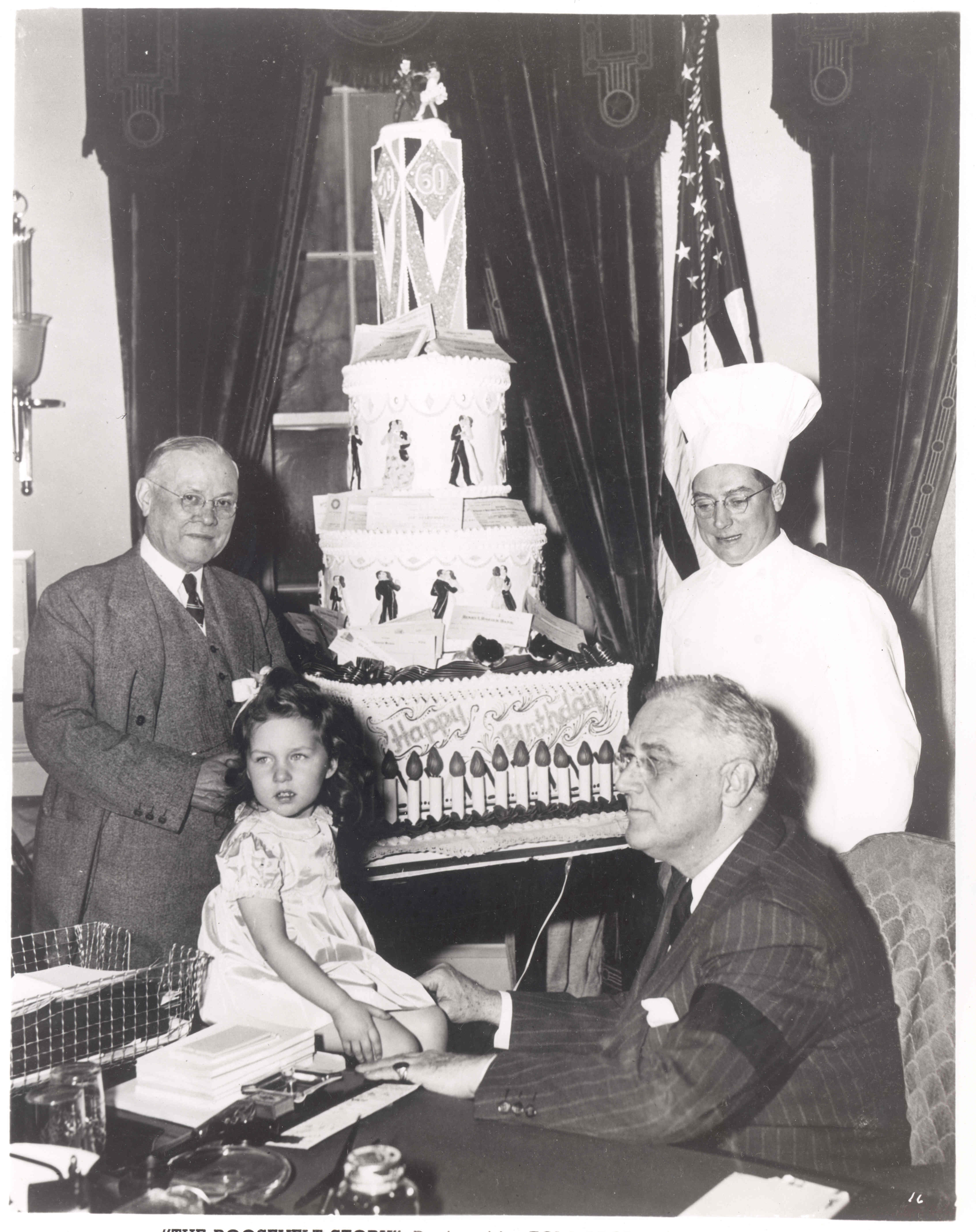 fdr in roosevelt history fdr pictured receiving a birthday cake decorated checks for the national foundation for infantile paralysis