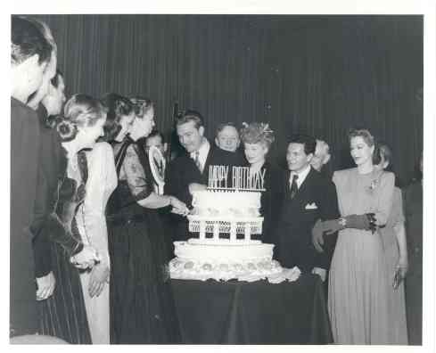 Eleanor at FDR Birthday Ball at the Statler Hotel in Washington DC, with Red Skelton, William O. Douglas, Lucille Ball, John Garfield, and Maria Montez. January, 1944.