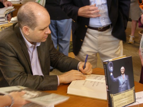 """Political commentator and historian Jonathan Alter signs copies of his book """"The Defining Moment"""" at the 2006 Reading Festival."""
